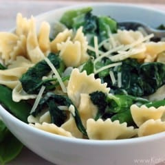 A horizontal photo with a white bowl of pasta with Snap Peas, Basil, and Spinach