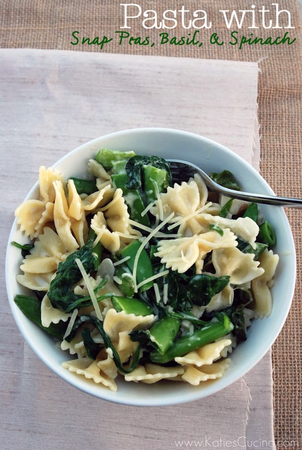 A vertical phot of a white bowl of Pasta with Snap Peas, Basil, and Spinach with text on the image