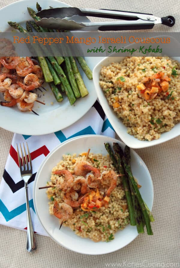 Top view of two plates with shrimp skewers sitting on top of israeli couscous.