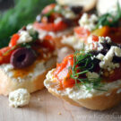 Crostini topped with whipped feta, tomato, kalamata olives and dill.