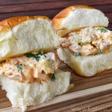 close up of two sets of slider buns filled with buffalo chicken salad mixture.