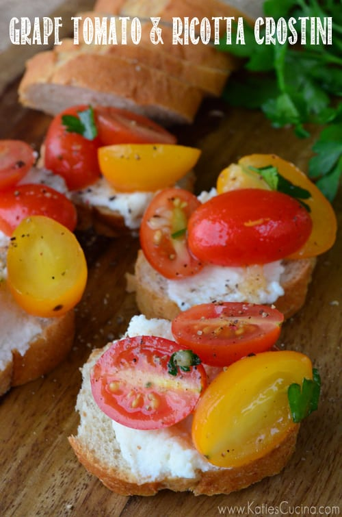 Four slices of crostini top with ricotta and tomatoes with text on image for Pinterest.