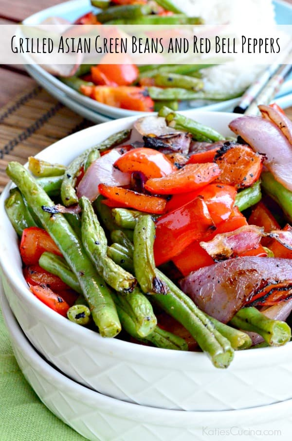 White bowl filled with grilled green beans, bell peppers, and red onions with text on image for Pinterest.