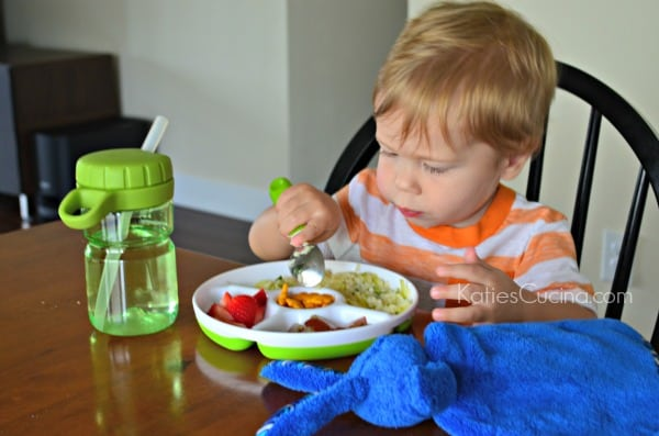 Toddler using OXO Tot feeding set
