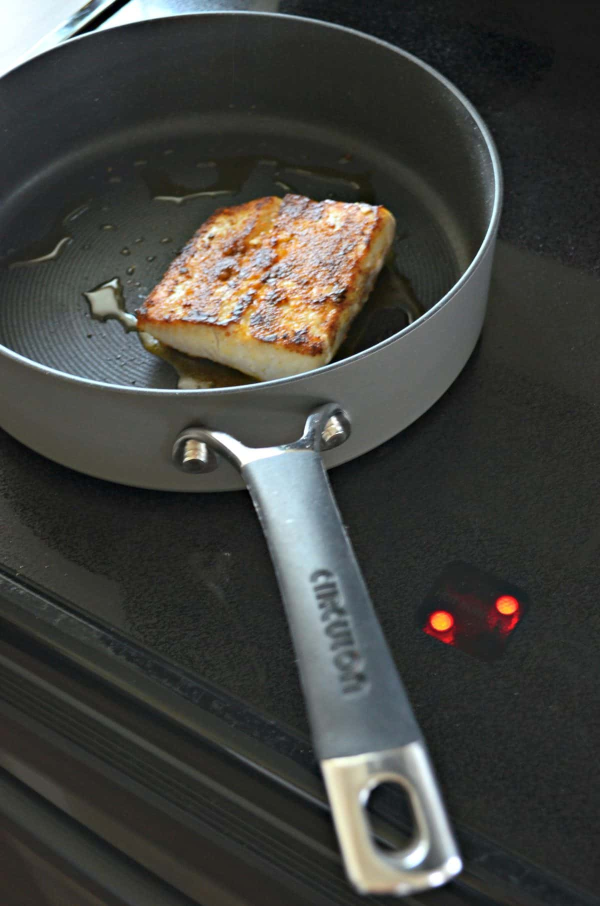 Mahi Mahi Searing in pan with oil.