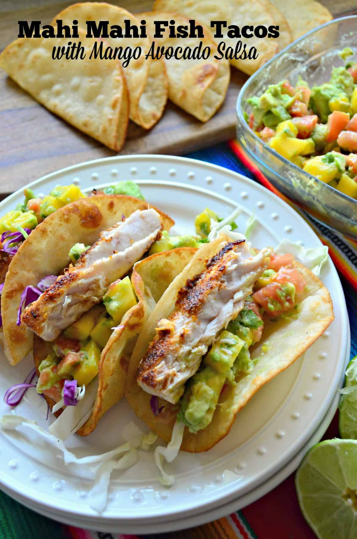 3 plated Mahi Mahi Fish Tacos with Mango Avocado Salsa and purple cabbage with title text.