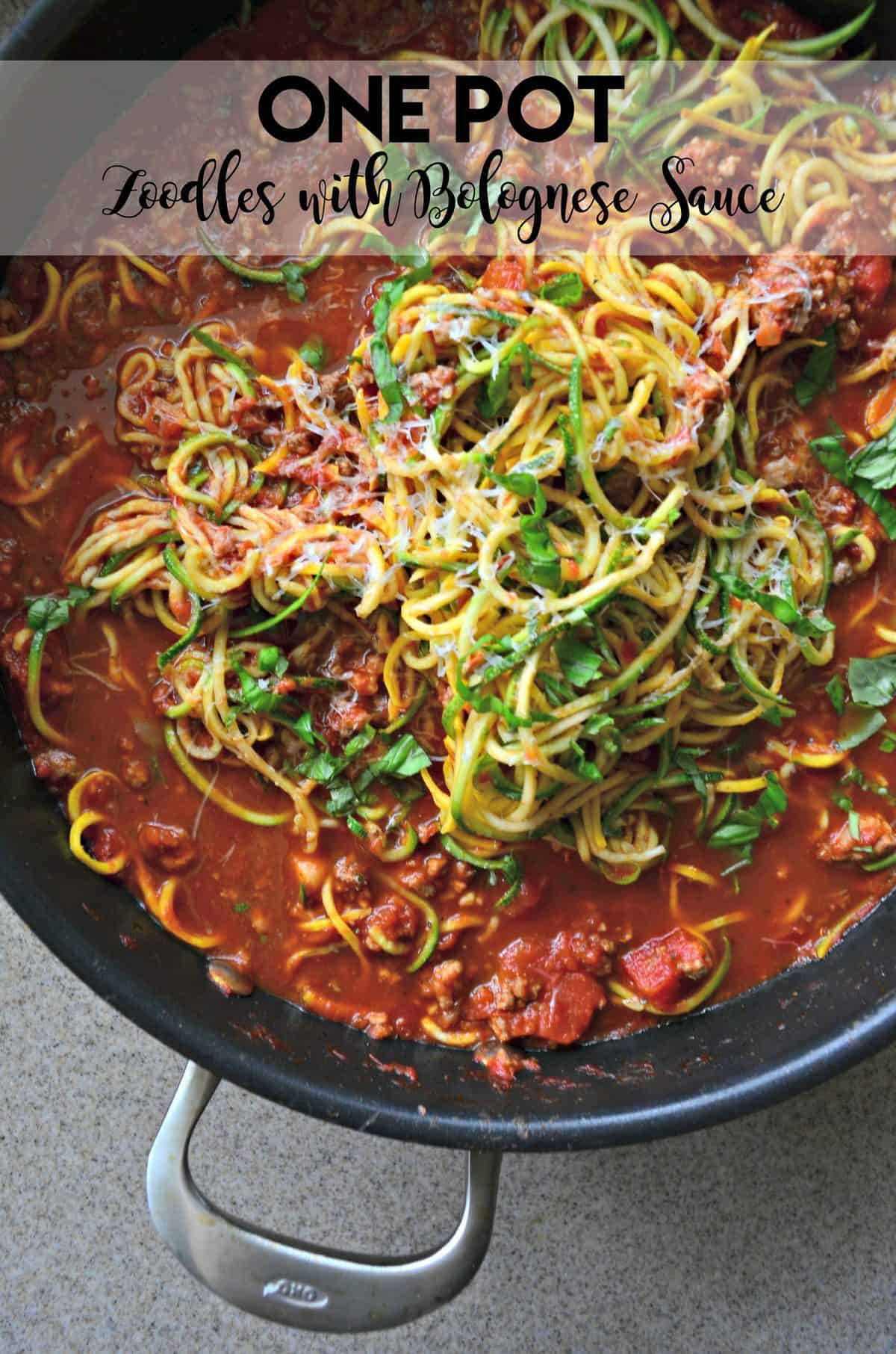 Close up of a pot of zoodles with meat sauce with text on image for Pinterest.