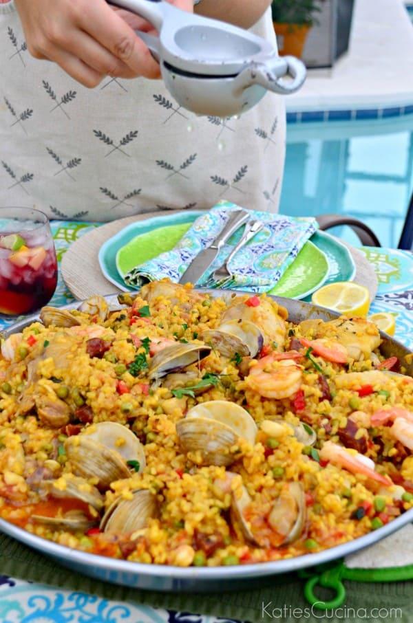 Seafood Paella Party squeezing lemon juice #CelebrateOutdoors