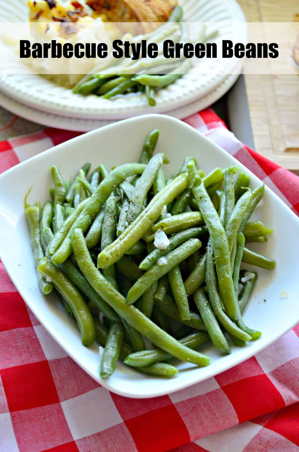white square dish of cooked green beans in front of paper plate of green beans with other sides and title text.