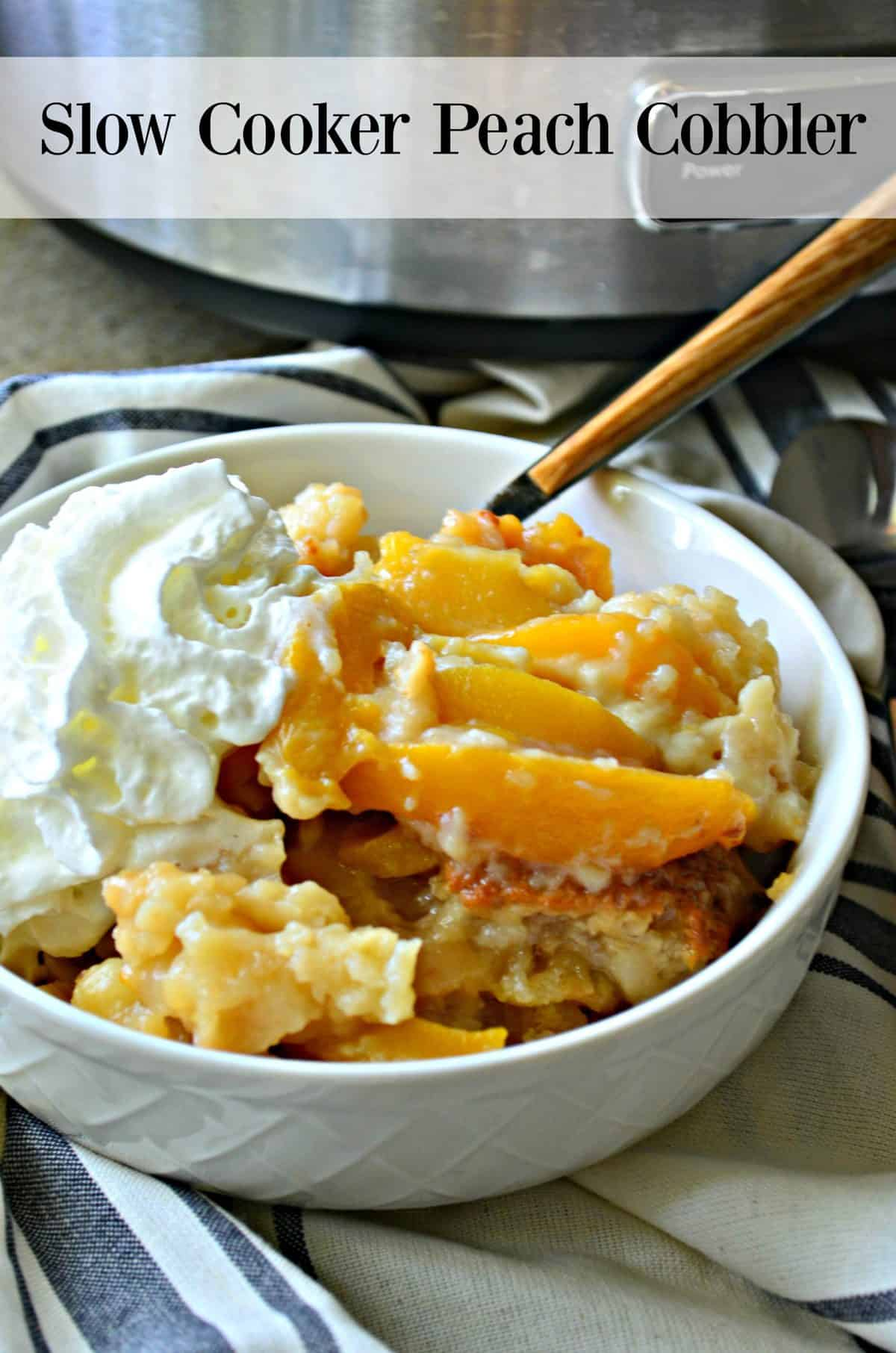 Top view of white dish filled with peach slices, whipped cream, and cobbler with title text.