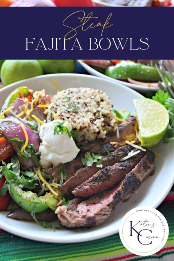 White bowl filled with sliced medium steak, quinoa, lime, sour cream and recipe title text on image for Pinterest.