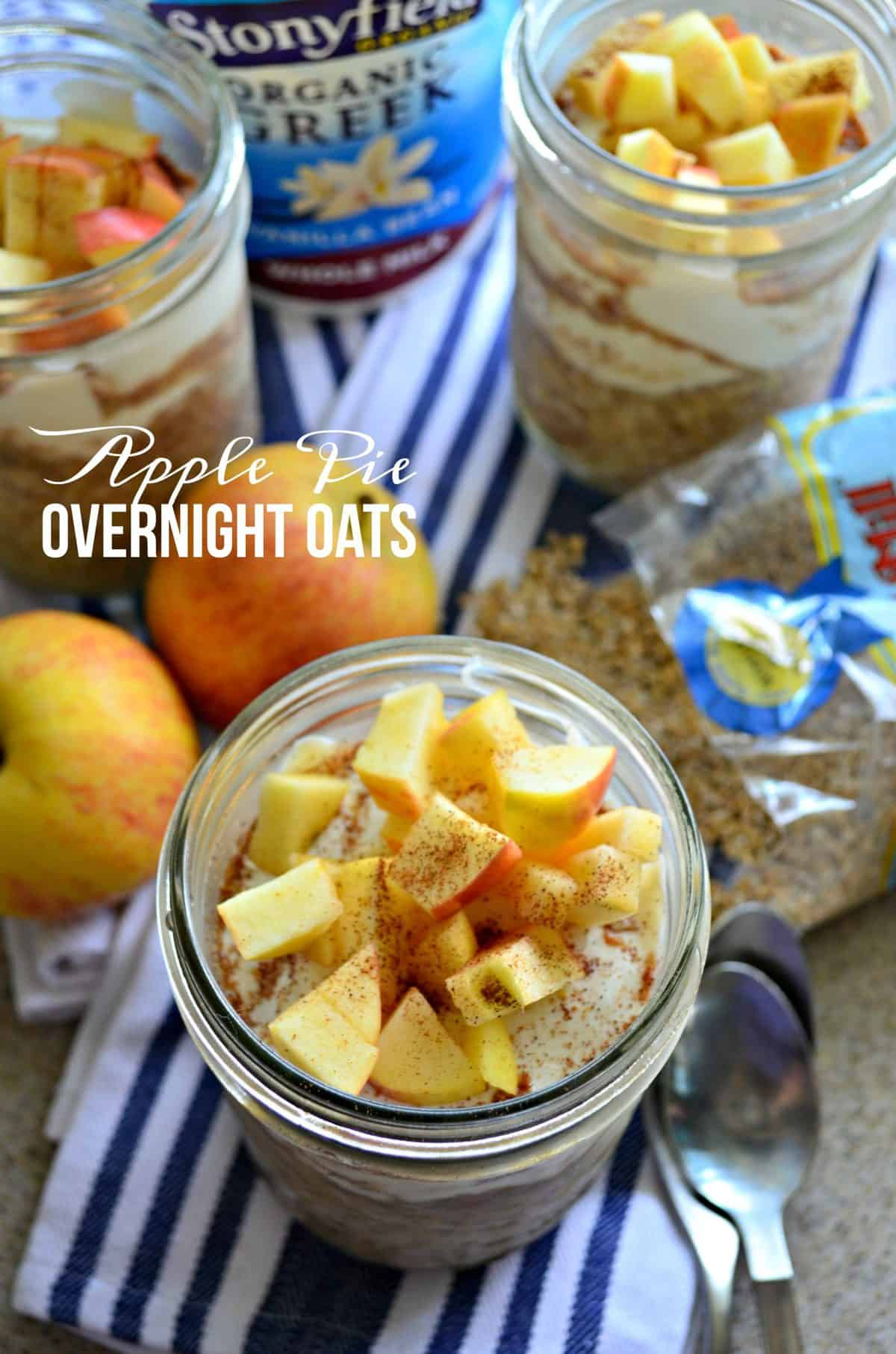 top view of 3 glasses filled with yogurt, oats, and topped with apple slices and cinnamon with title text.