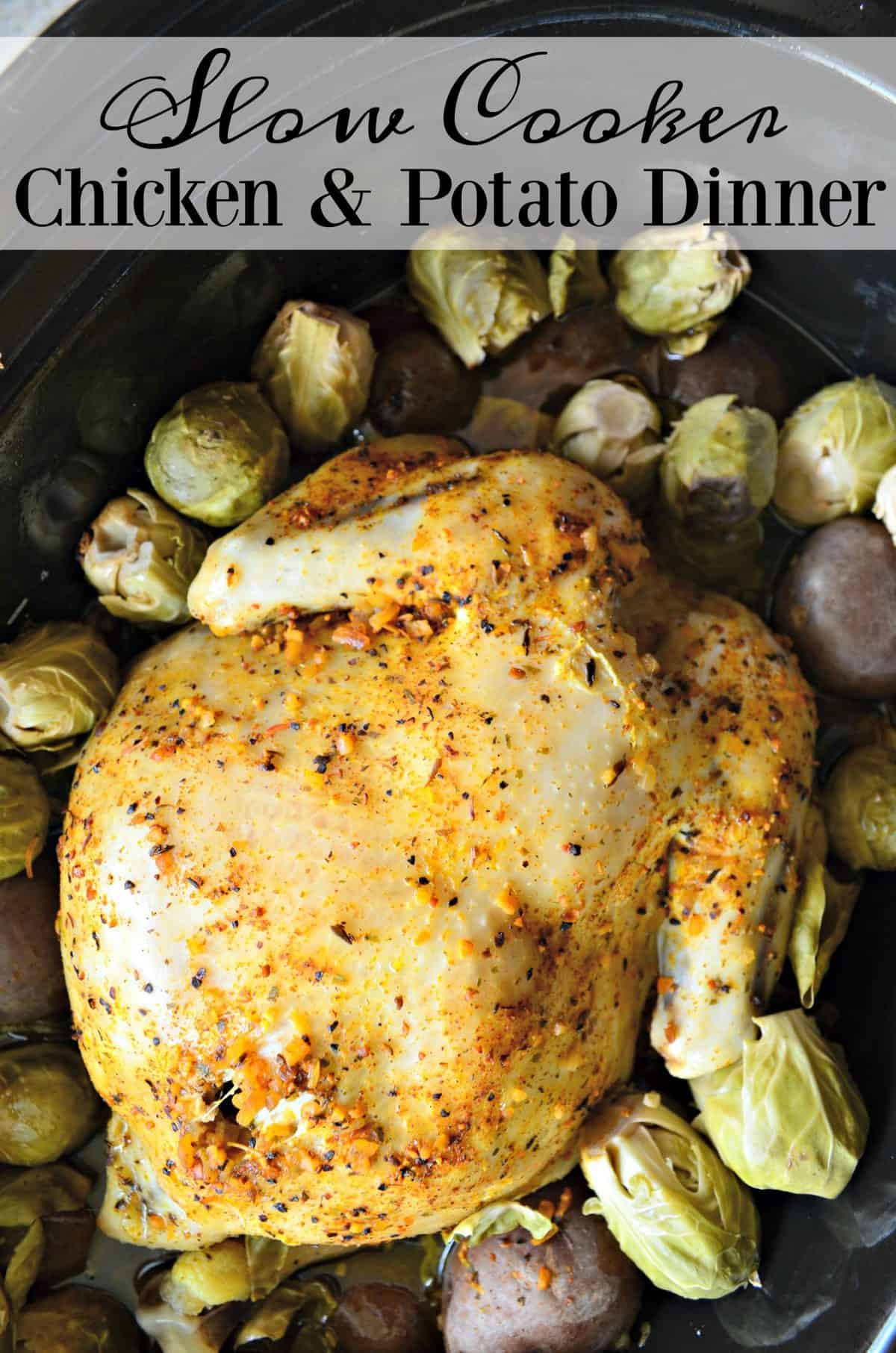top view of Golden browned chicken topped with herbs in slow cooker with potatoes and brussels sprouts with title text.