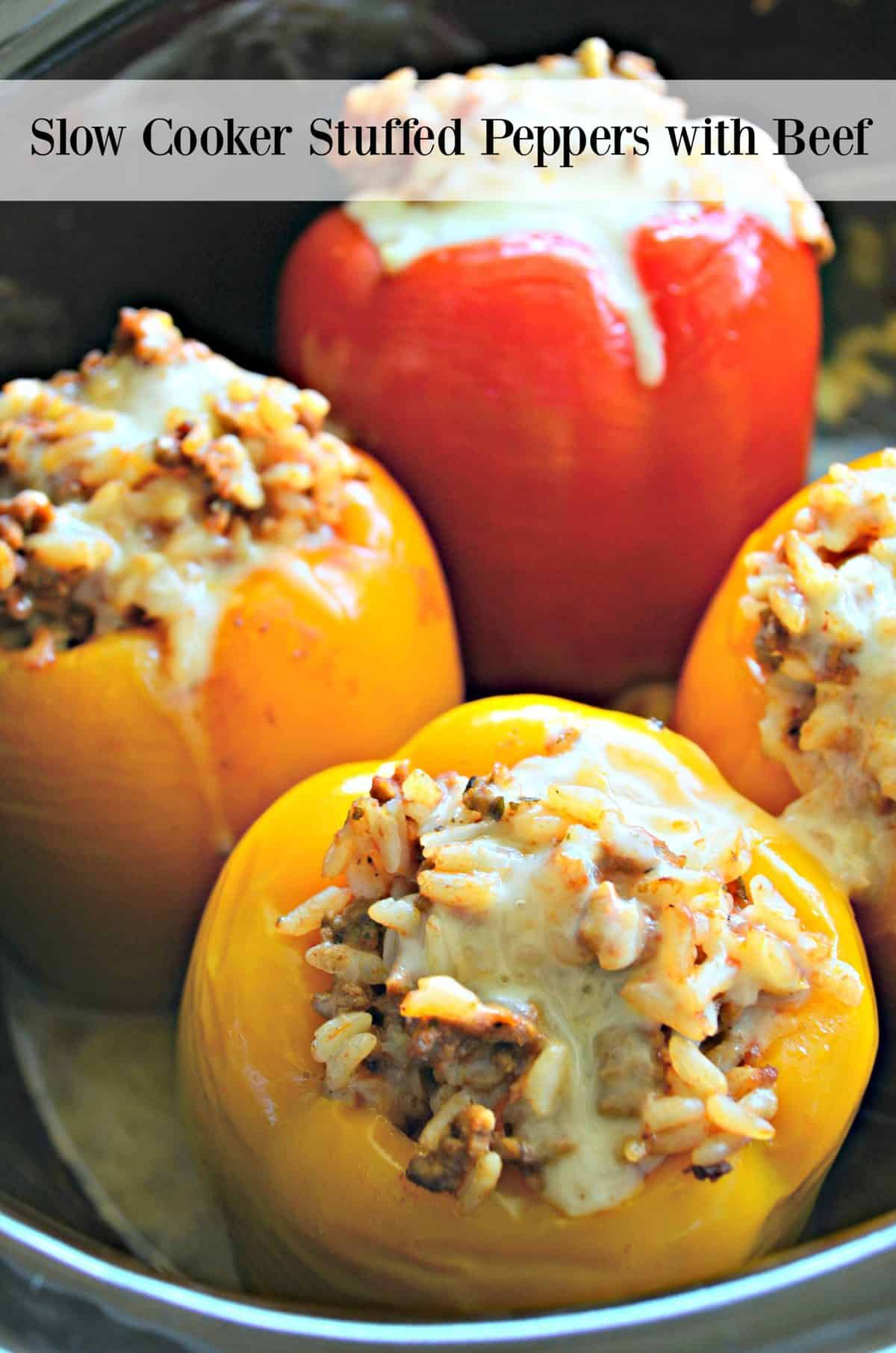 closeup of 4 bell peppers stuffed with rice and meat, topped with cheese with title text.