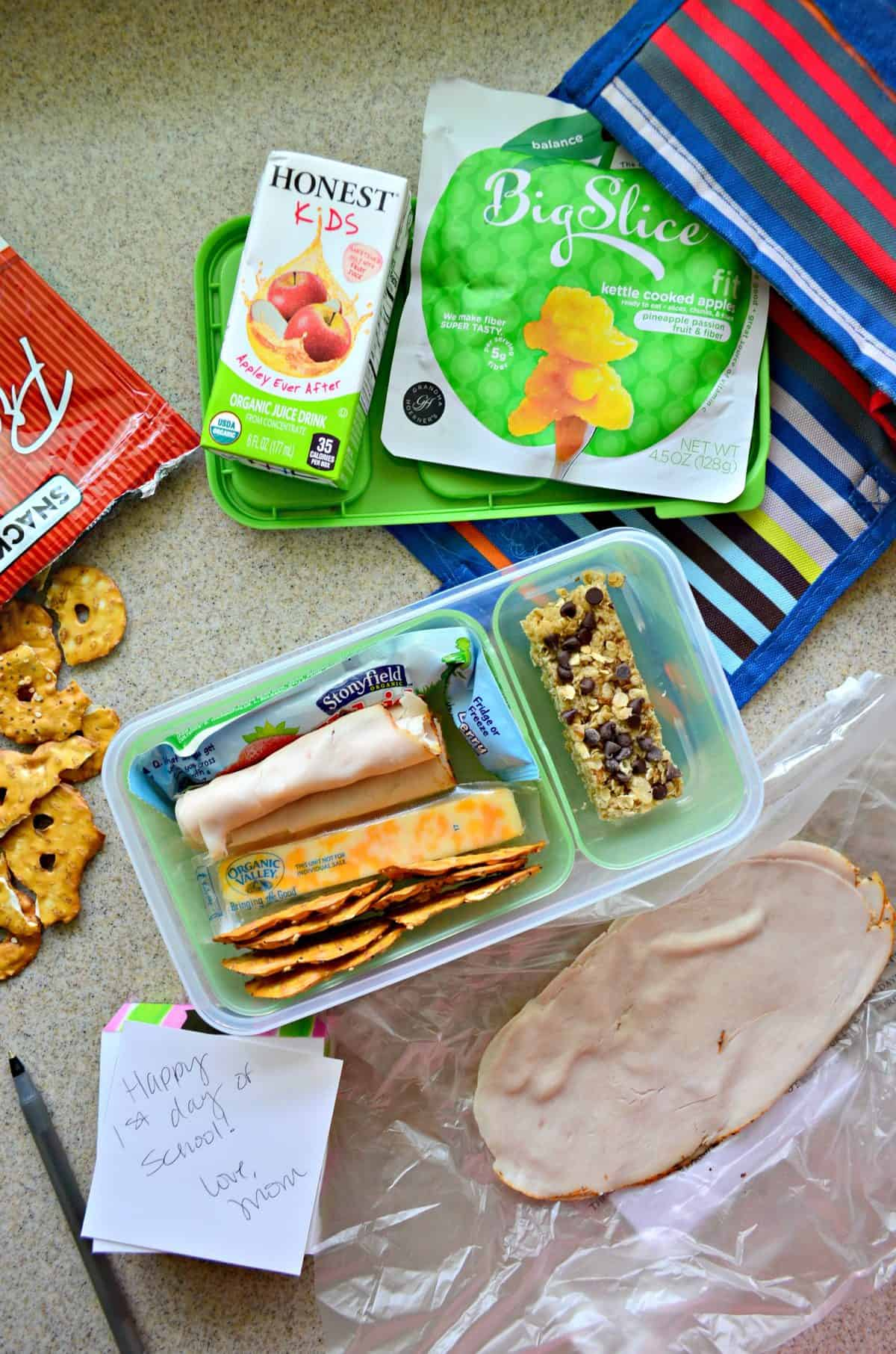 Pinterest cover page with open lunchbox container filled with kid's lunch items.
