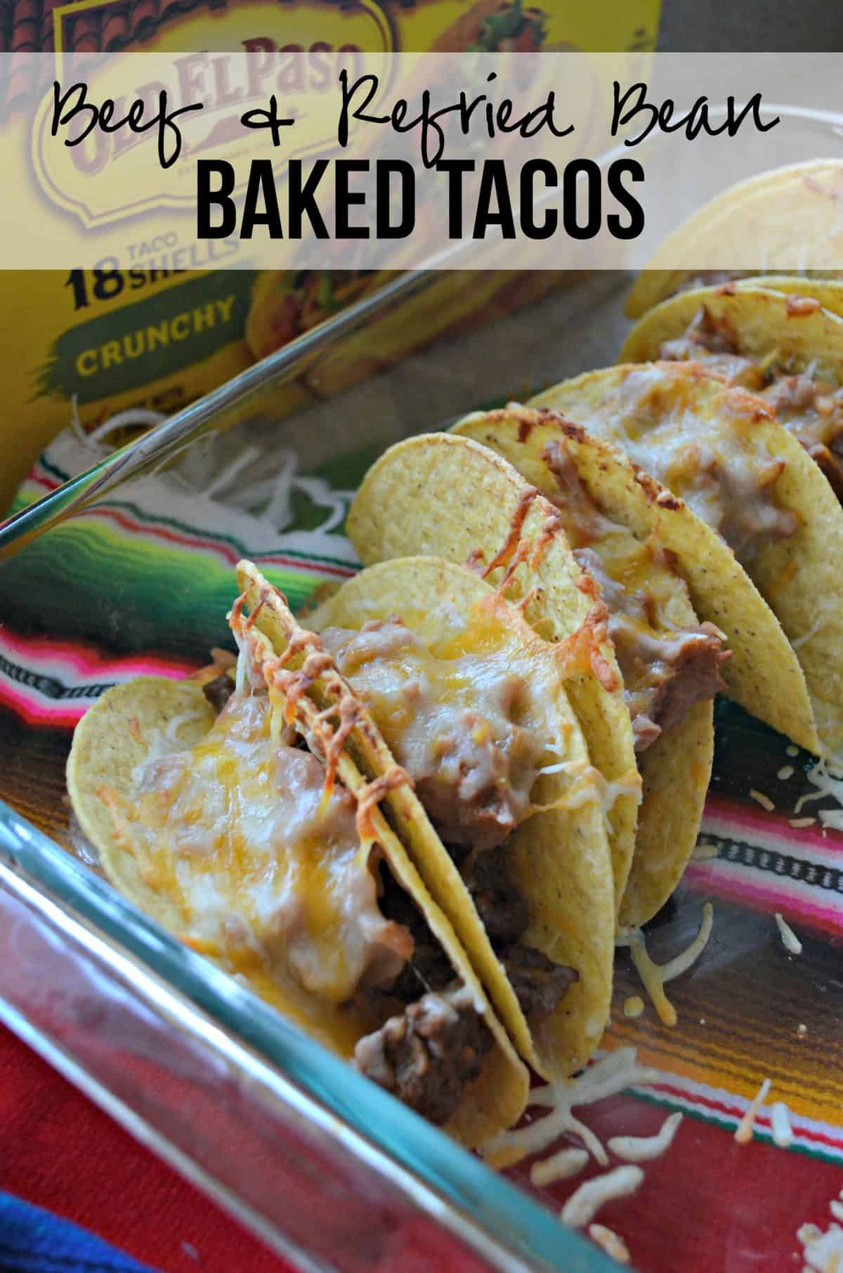casserole dish of hard shell tacos covered in melted cheese with refried beans showing with title text.