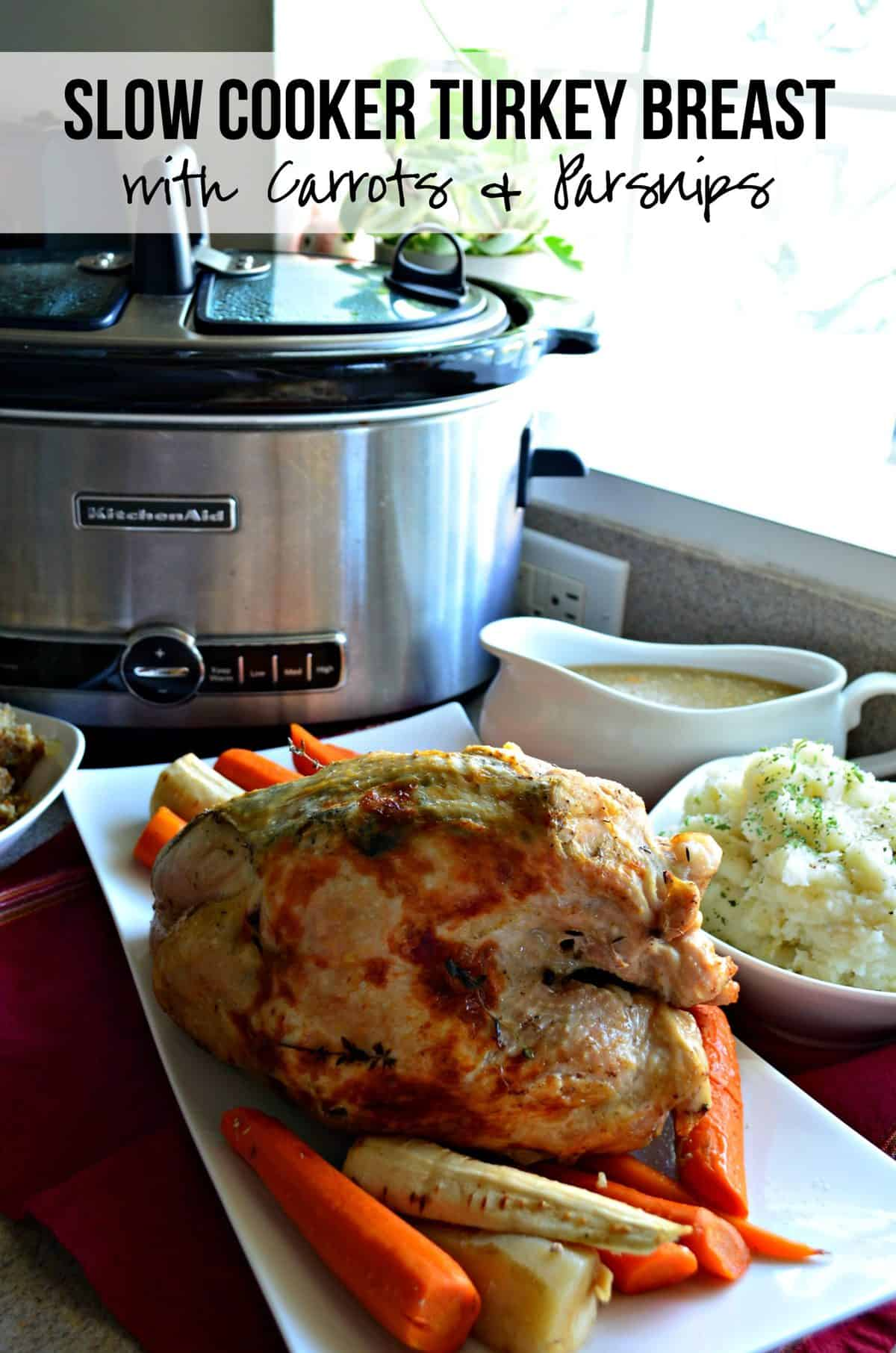 whole cooked turkey with Carrots & Parsnips on rectangular platter next to bowl of mashed potatoes and gravy boat.