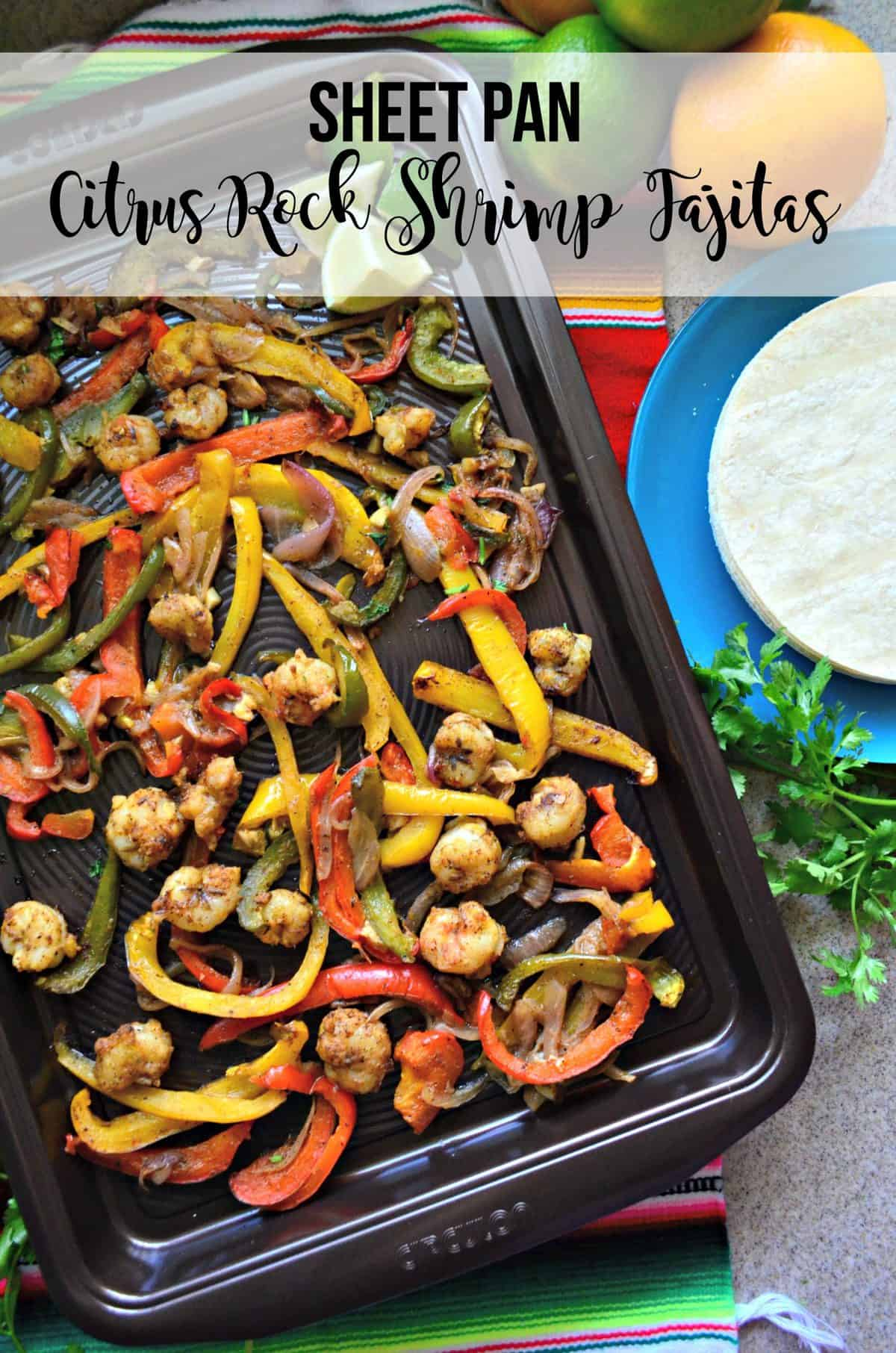 seasoned shrimp, sliced bell peppers, and onions on a sheet pan with lime and title text.