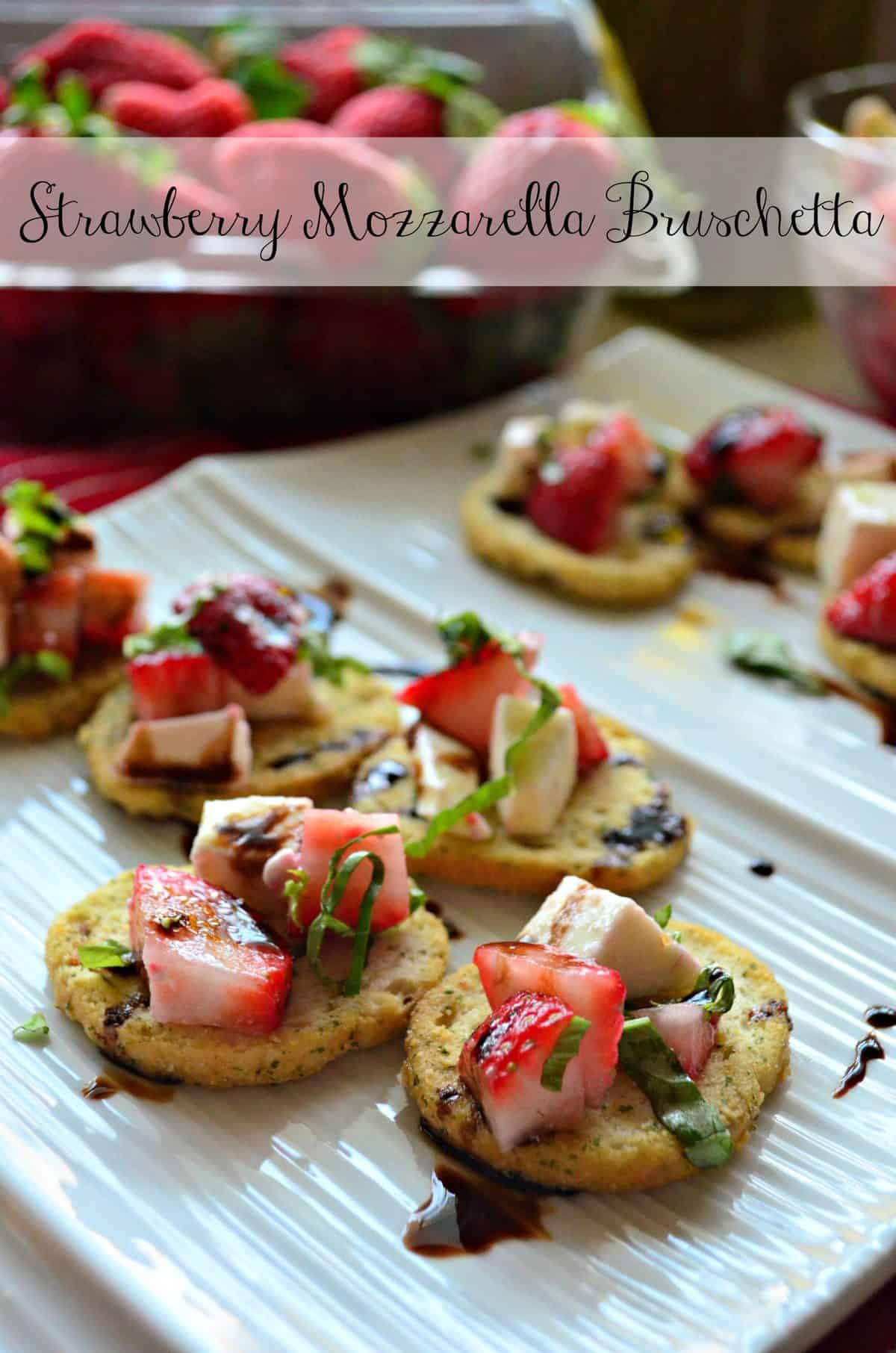 closeup of herbed crackers topped with strawberries, cheese, balsamic, and basil with title text.