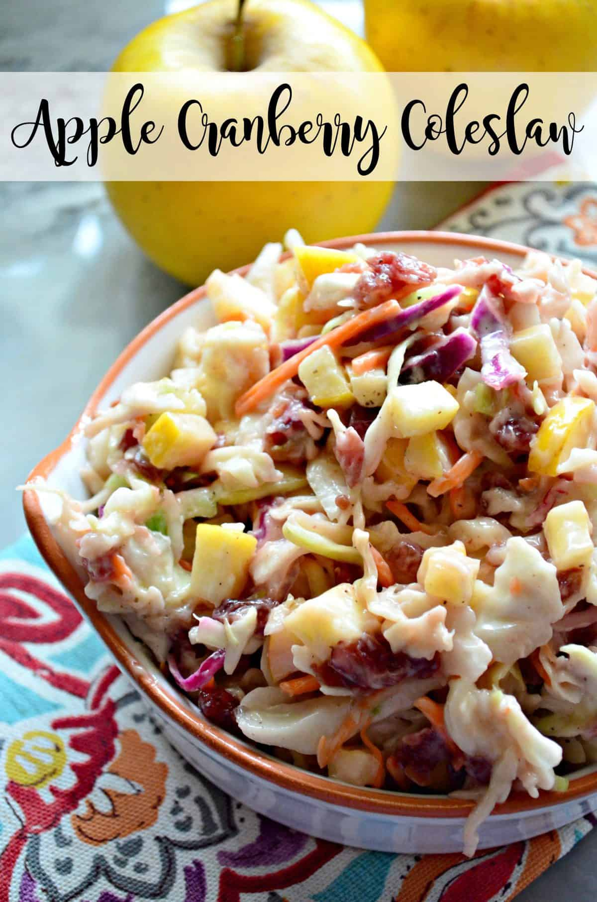 close up top view of shredded carrots, cabbage, and apple slices with sauce in small bowl with title text.