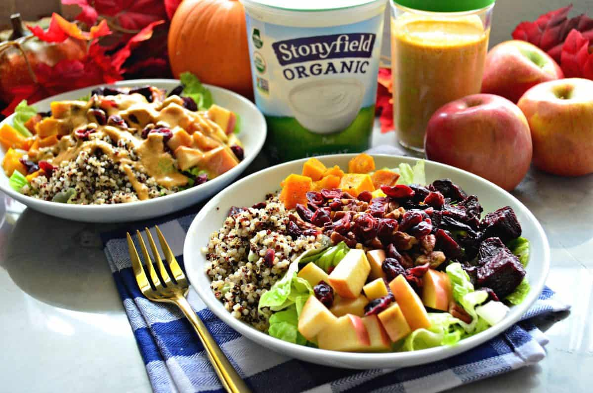 2 bowls of quinoa with beets, pumpkin, apple, cranberry, lettuce, apple, and dressing by stonyfield organic yogurt.