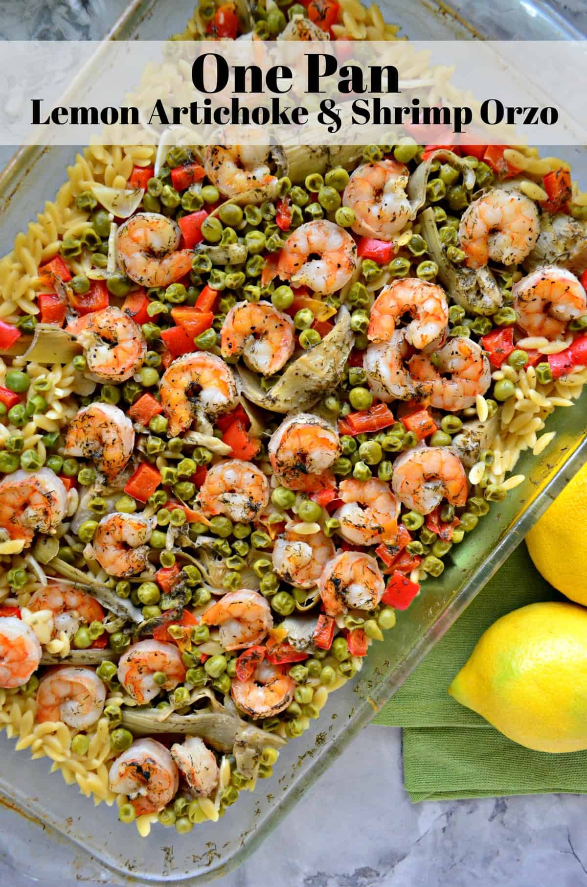 top view of shrimp, bell pepper, peas, and orzo in a glass dish with title text.