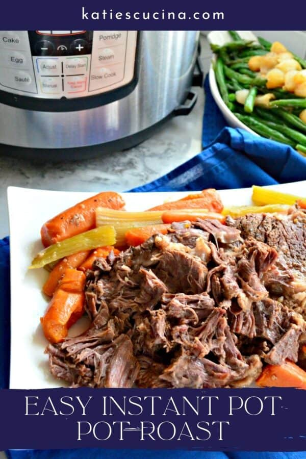 White platter filled with beef roast with carrots with text on image for Pinterest.