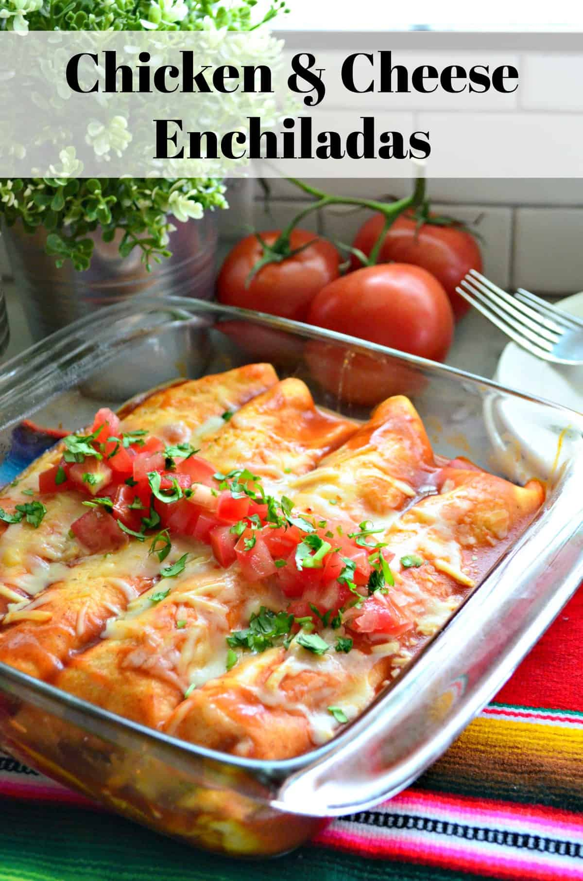 Enchiladas in glass dish topped with melted cheese, diced tomatoes, and cilantro with title text.