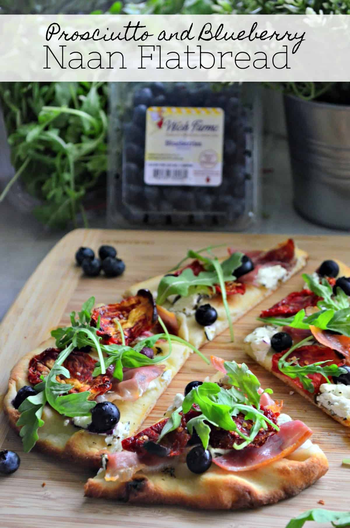 Flatbread topped with prosiutto, arugula, blueberries, cheese, and sundried tomato with title text.