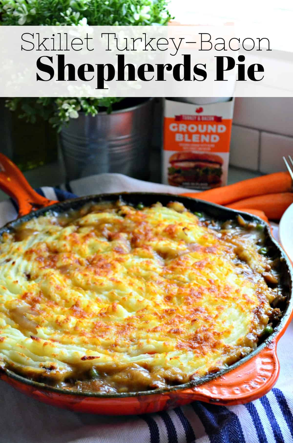 Top view of browned mashed potatoes in skillet over with title text.