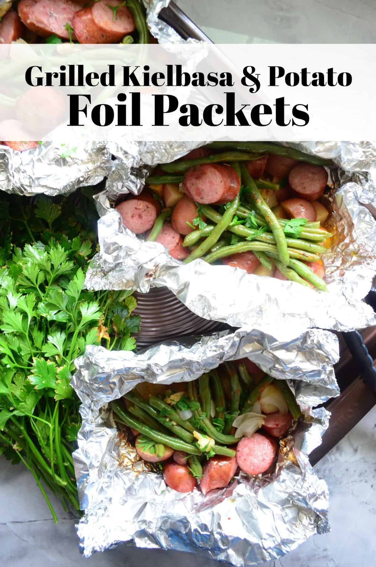 Grilled Kielbasa, Potato, green beans, and parsley in Foil Packets.
