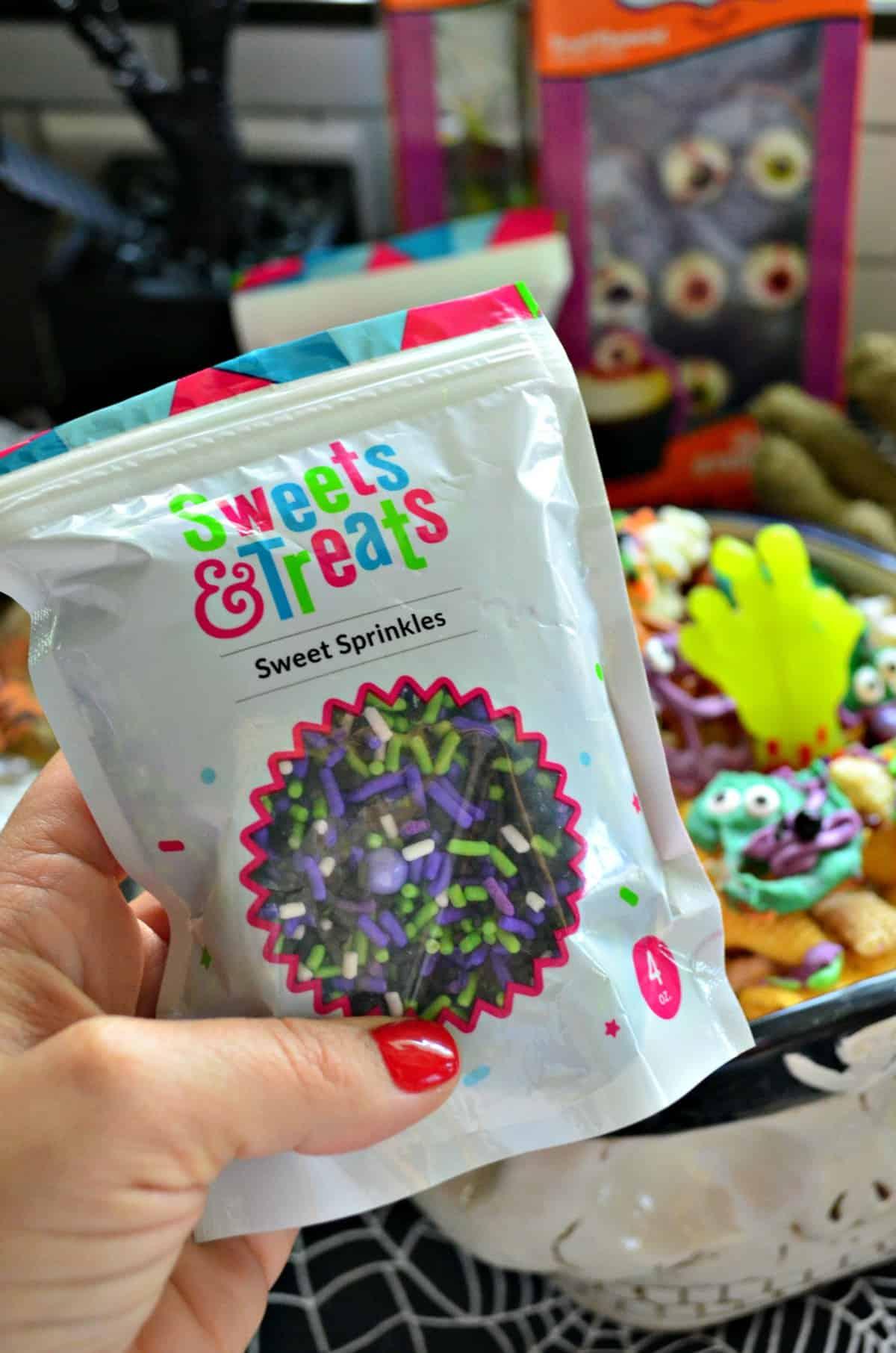 bag of purple, green, and black Sweets & Treats Sweet sprinkles.