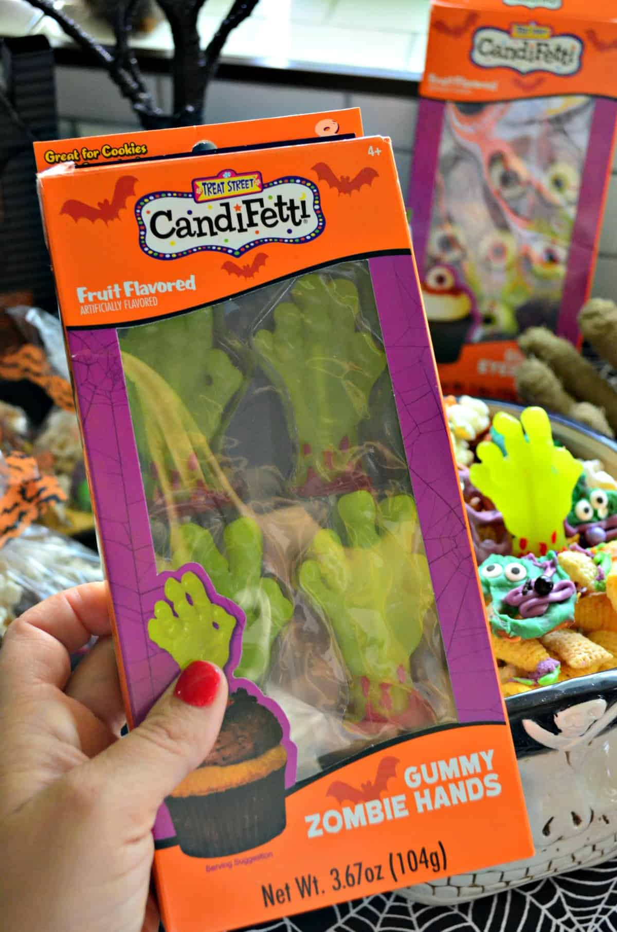 box of candifetti fruit flavored gummy zombie hands.