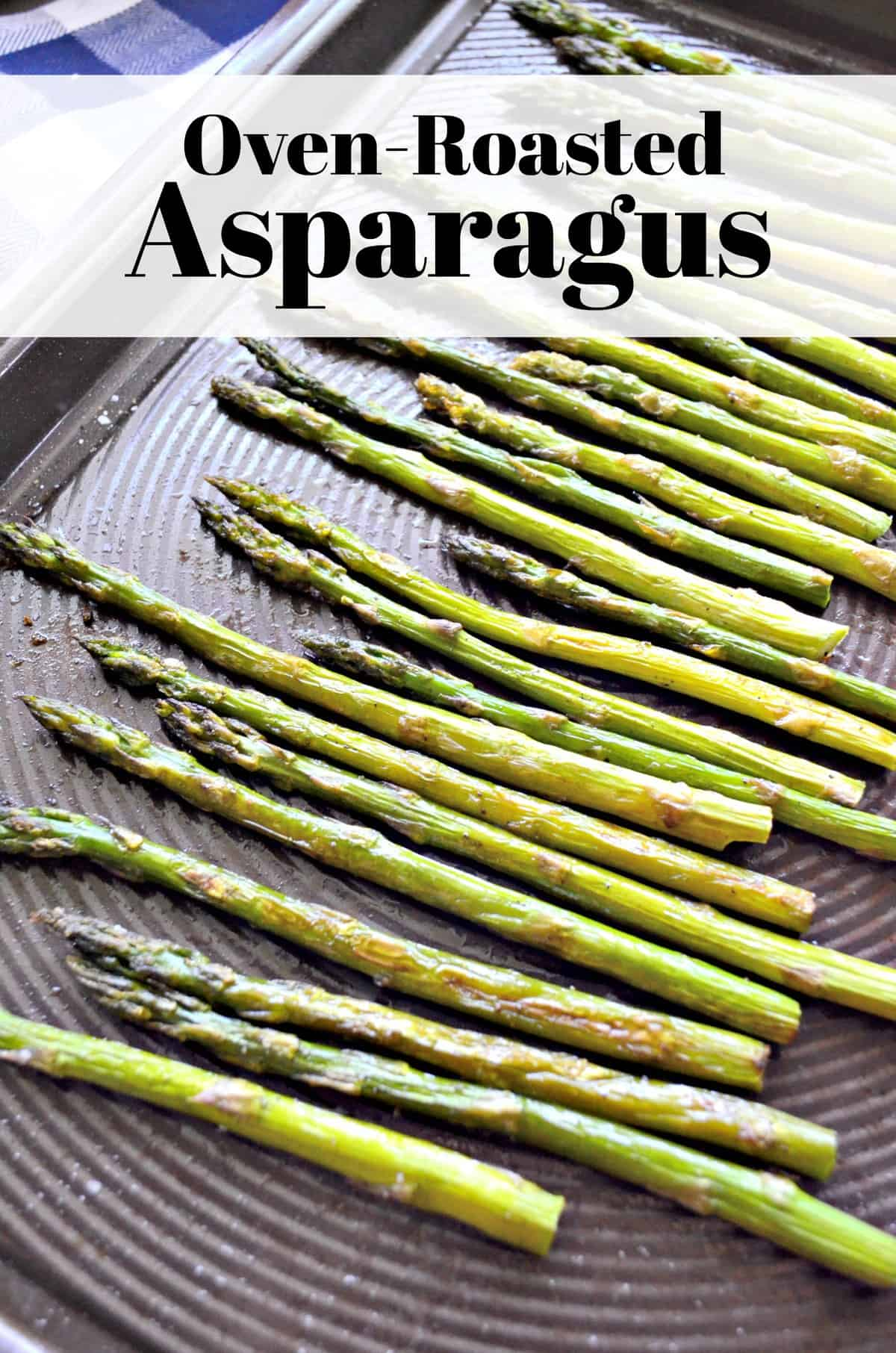 Top view of roasted asparagus on sheet pan sprinkled with salt and title text.
