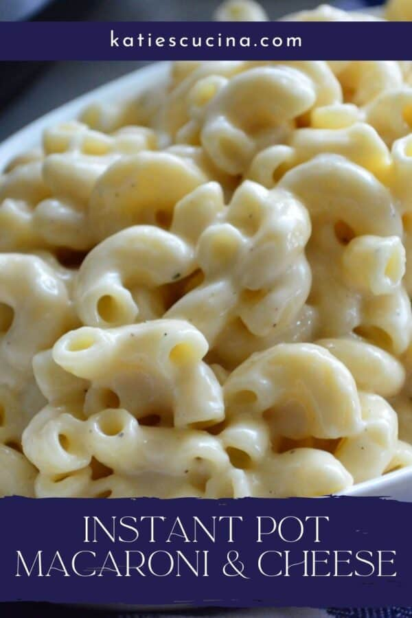 Close up of elbow macaroni's in cheese sauce with recipe title text on image for Pinterest.