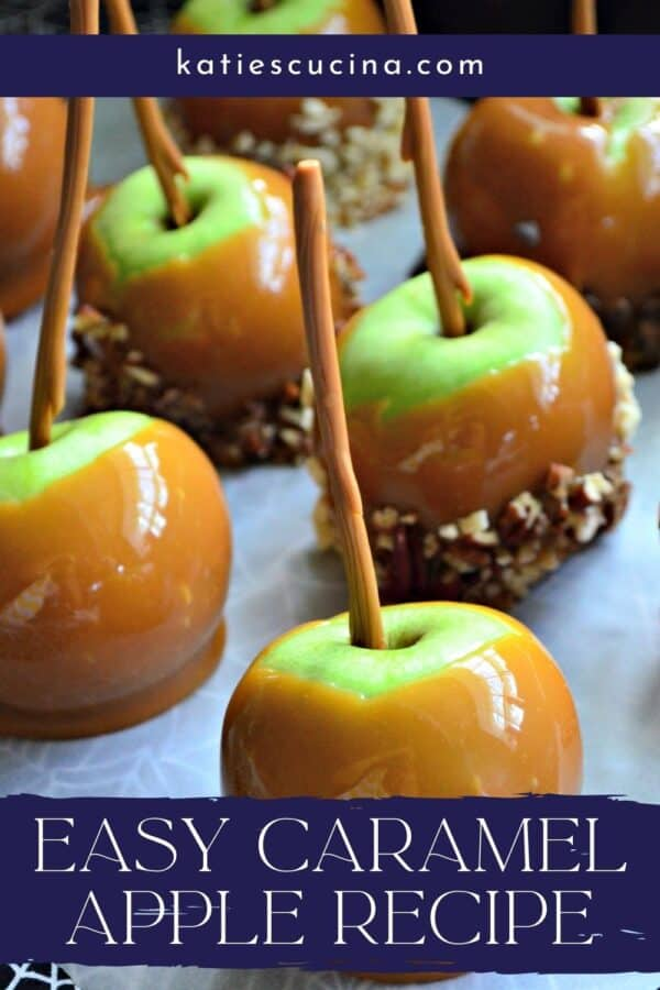 Six caramel apples on parchment with recipe title text on image for Pinterest.