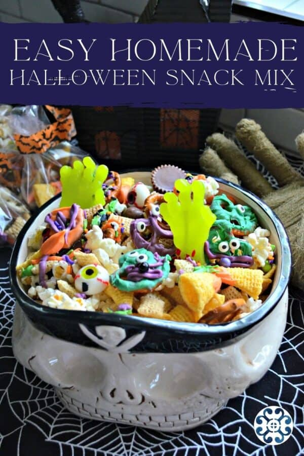 Pirate bowl filled with gummy zombie hands, bugels, popcorn, and other candy with recipe tite text on image for Pinterest.