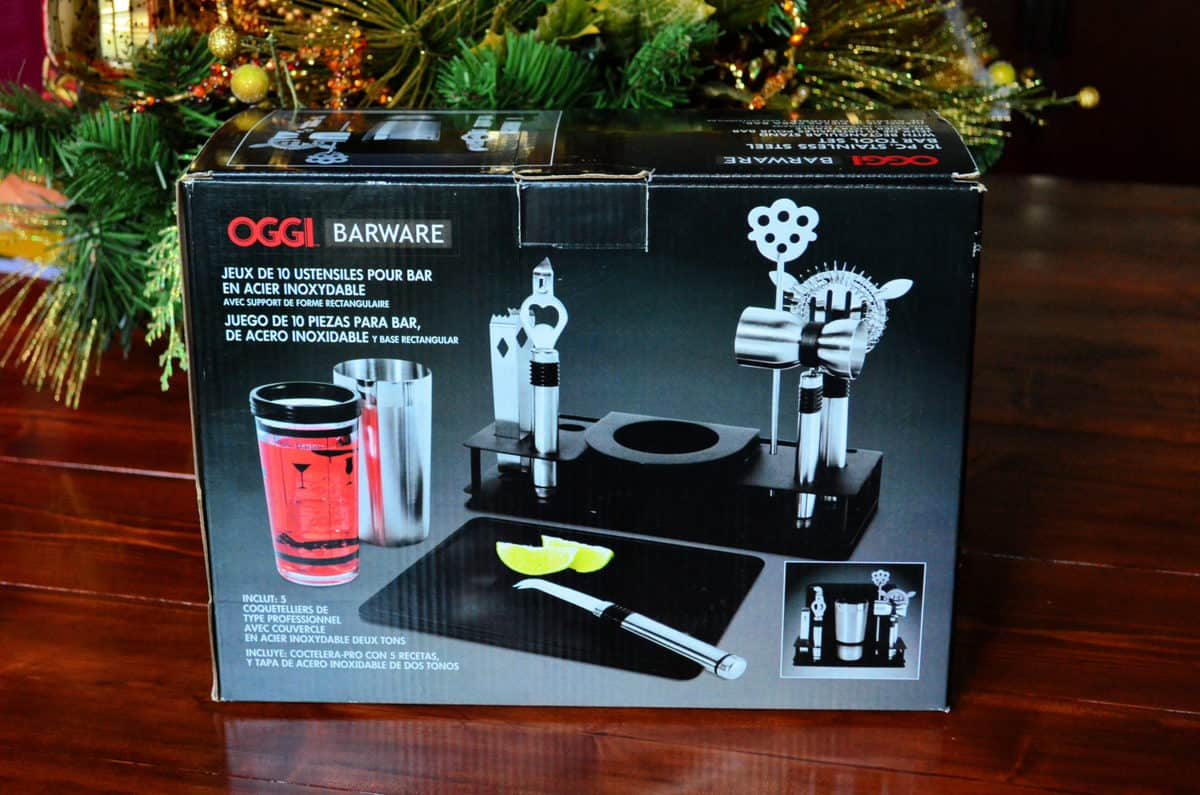 Oggi Pro Stainless-Steel 10-Piece Cocktail Shaker and Bar Tool Set in front of Christmas tree.