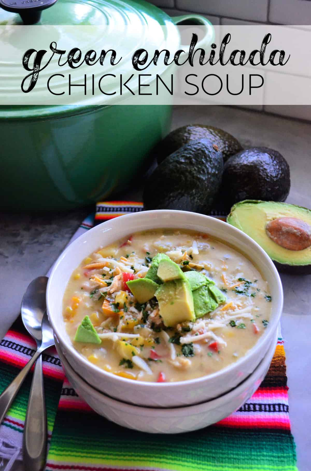 Green Enchilada Chicken Soup in bowl topped with cheese and avocado with title text.