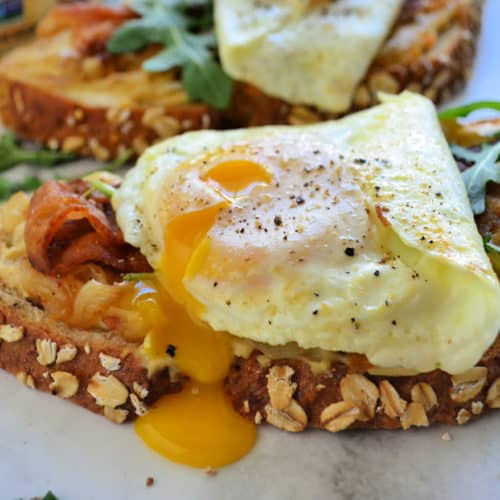 close up of Bacon, Egg, and Caramelized Onion Hummus Toast