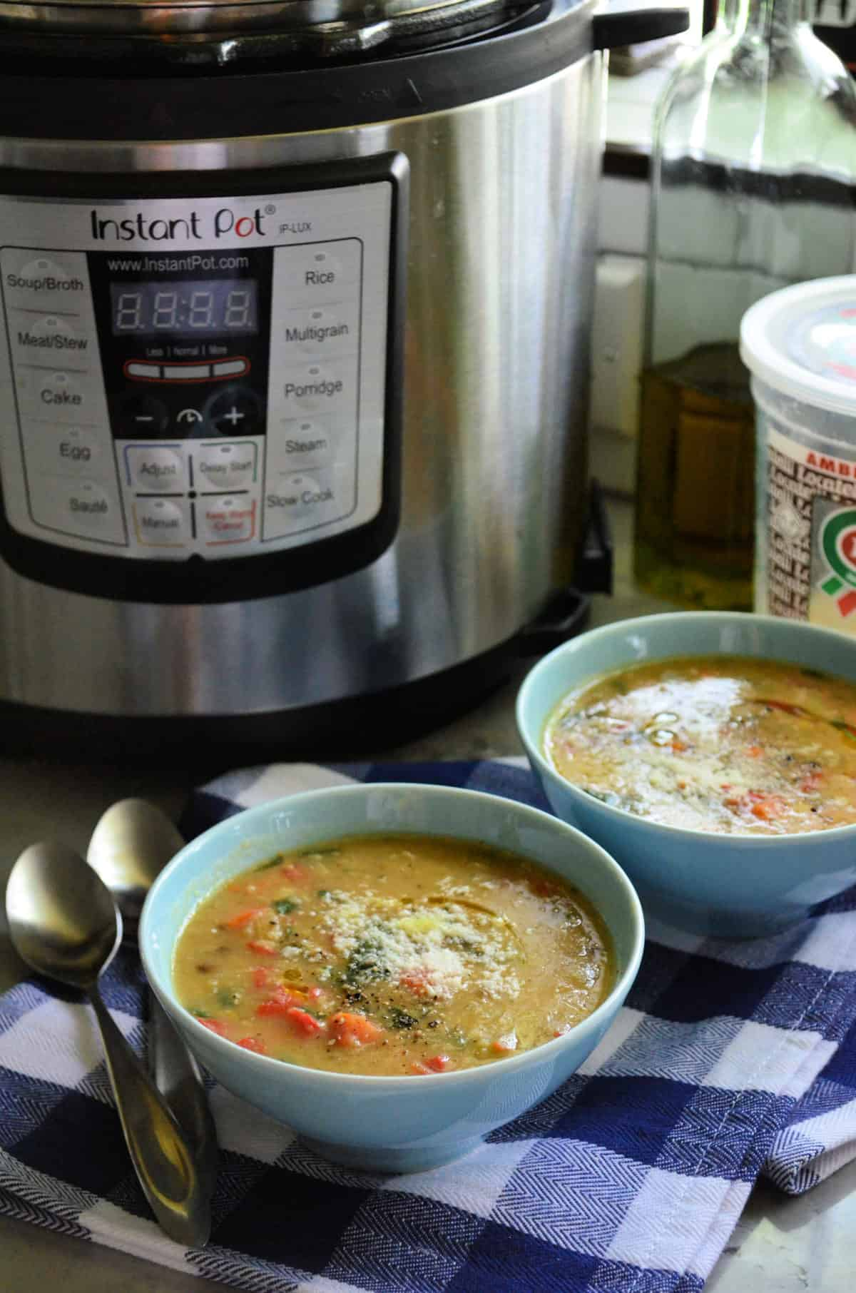 2 bowls of vegetable soup topped with parmesan cheese in front of instant pot with title text.