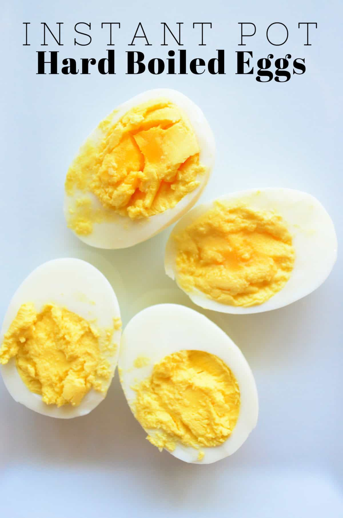 4 halves of hard boiled eggs yolk up with white background and title text.