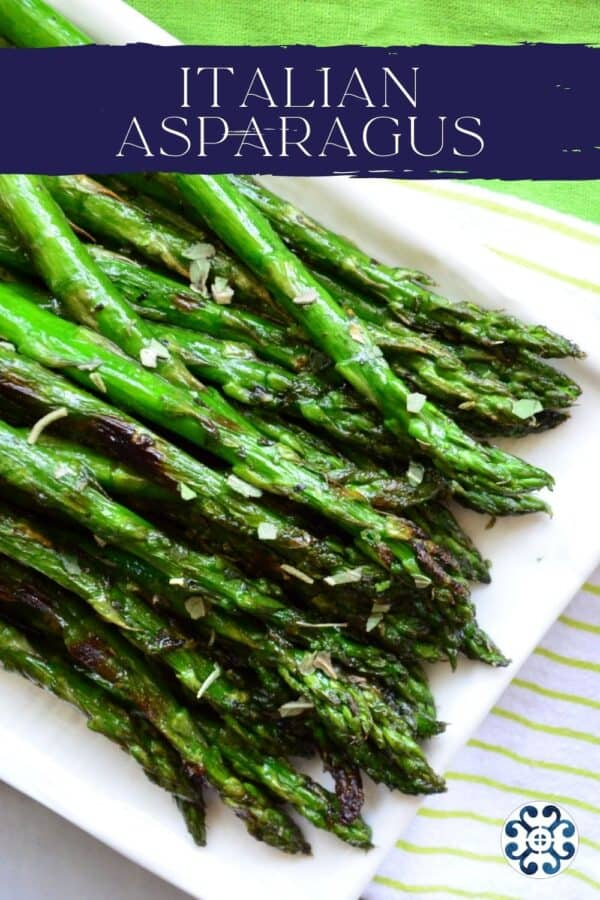 Top view of a Grilled Italian asparagus on a white plate with recipe title text on image for Pinterest.