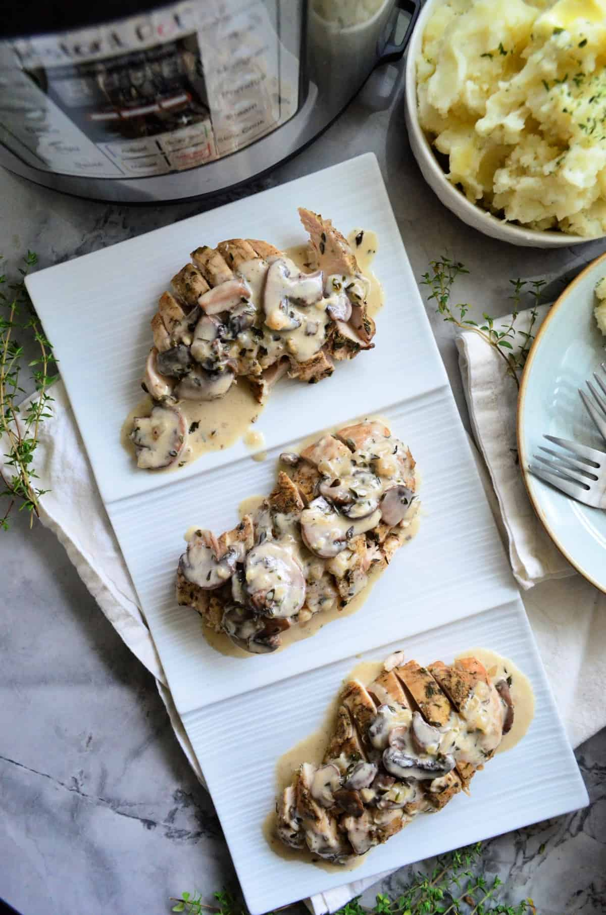 top view of 3 Sliced Turkey Tenderloins each plated with mushroom gravy.