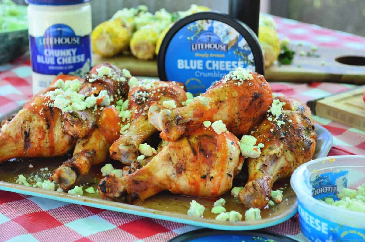 Grilled Buffalo Chicken Drumsticks with Blue Cheese Crumbles