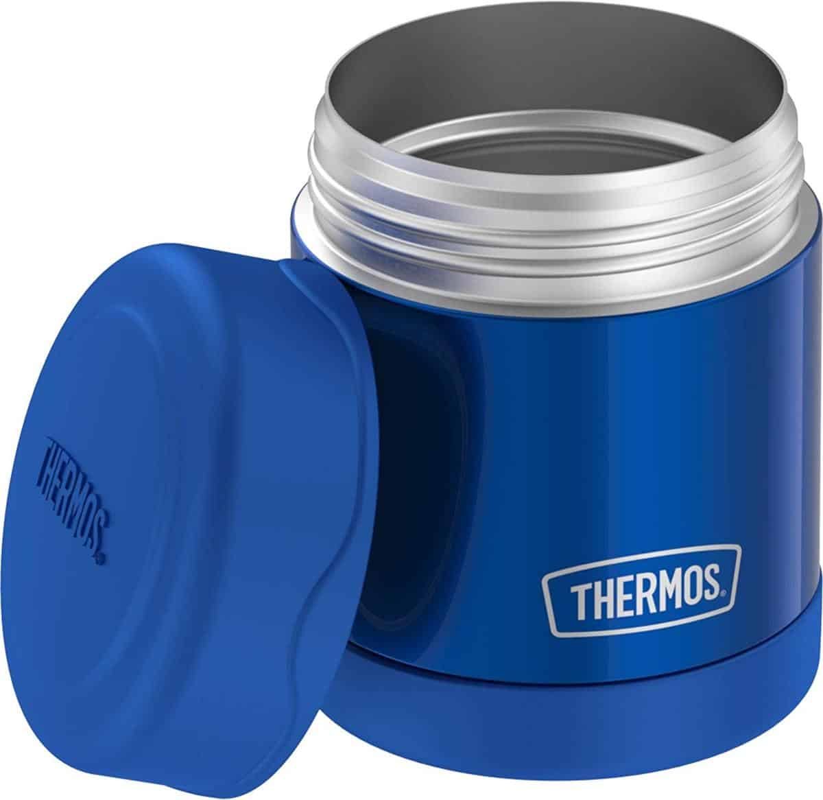 Blue Thermos Funtainer 10 Ounce Food Jar with lid propped against the side.
