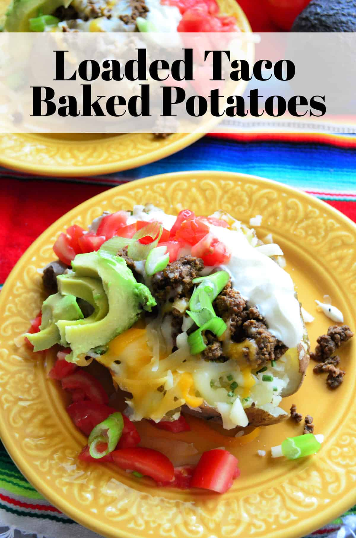 Top view of split baked potato with sour cream, meat, tomato, cheese, avocado with title text.