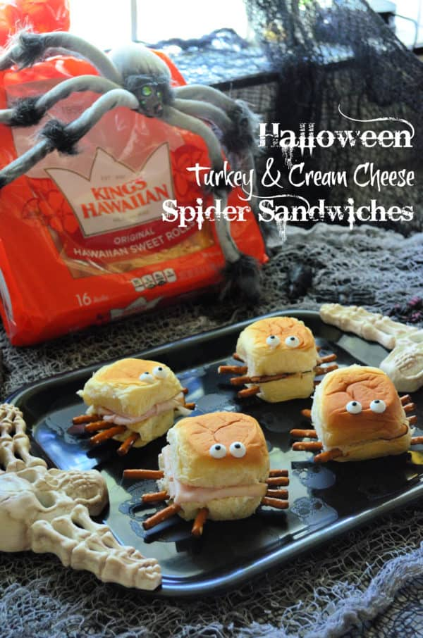 4 spider sandwiches in front of bag of Kings Hawaiian Sweet rolls with pinterest title text.