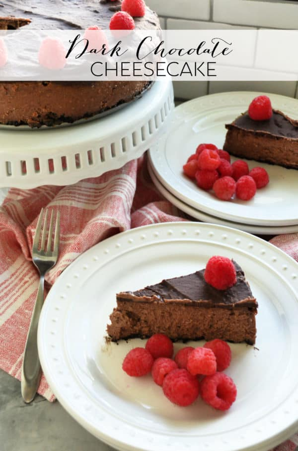 Slice of plated Dark Chocolate Raspberry Cheesecake in front of remaining cheesecake with pinterest title text.