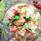 Top view Christmas Snack Mix with green and red m&ms and drizzled red and green chocolate.